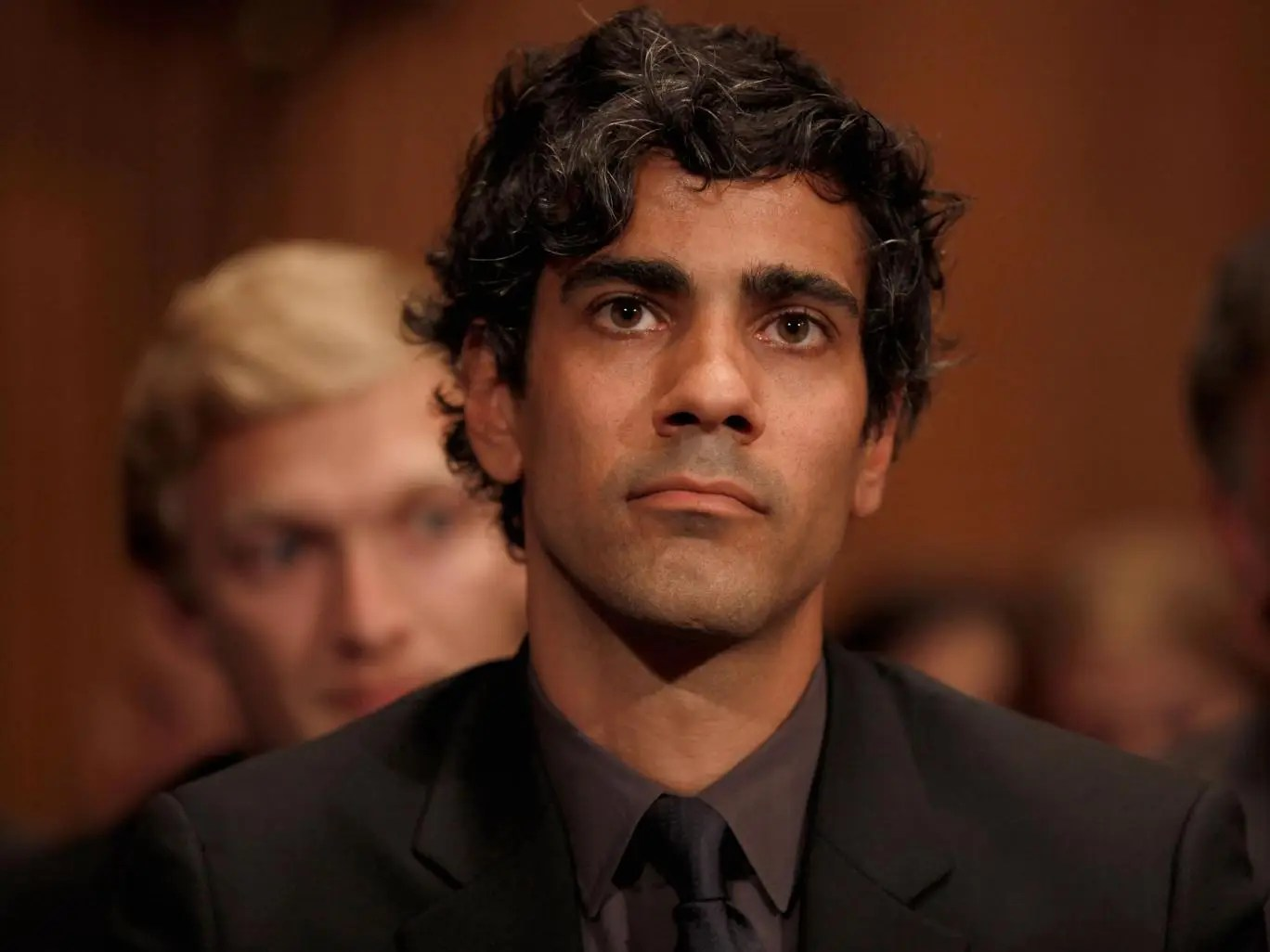 Yelp CEO Jeremy Stoppelman listens to Google Executive Chairman Eric Schmidt during a US Senate Judiciary hearing on alleged anti-competitive practices by Google in 2011