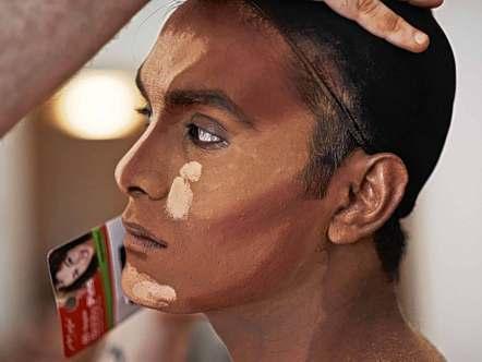 A still from Muslim Drag Queen showing an artist putting on their makeup