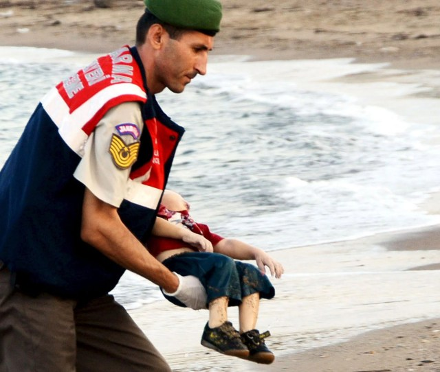A Turkish Rescue Worker Carries The Young Boy Who Drowned During A Failed Attempt To