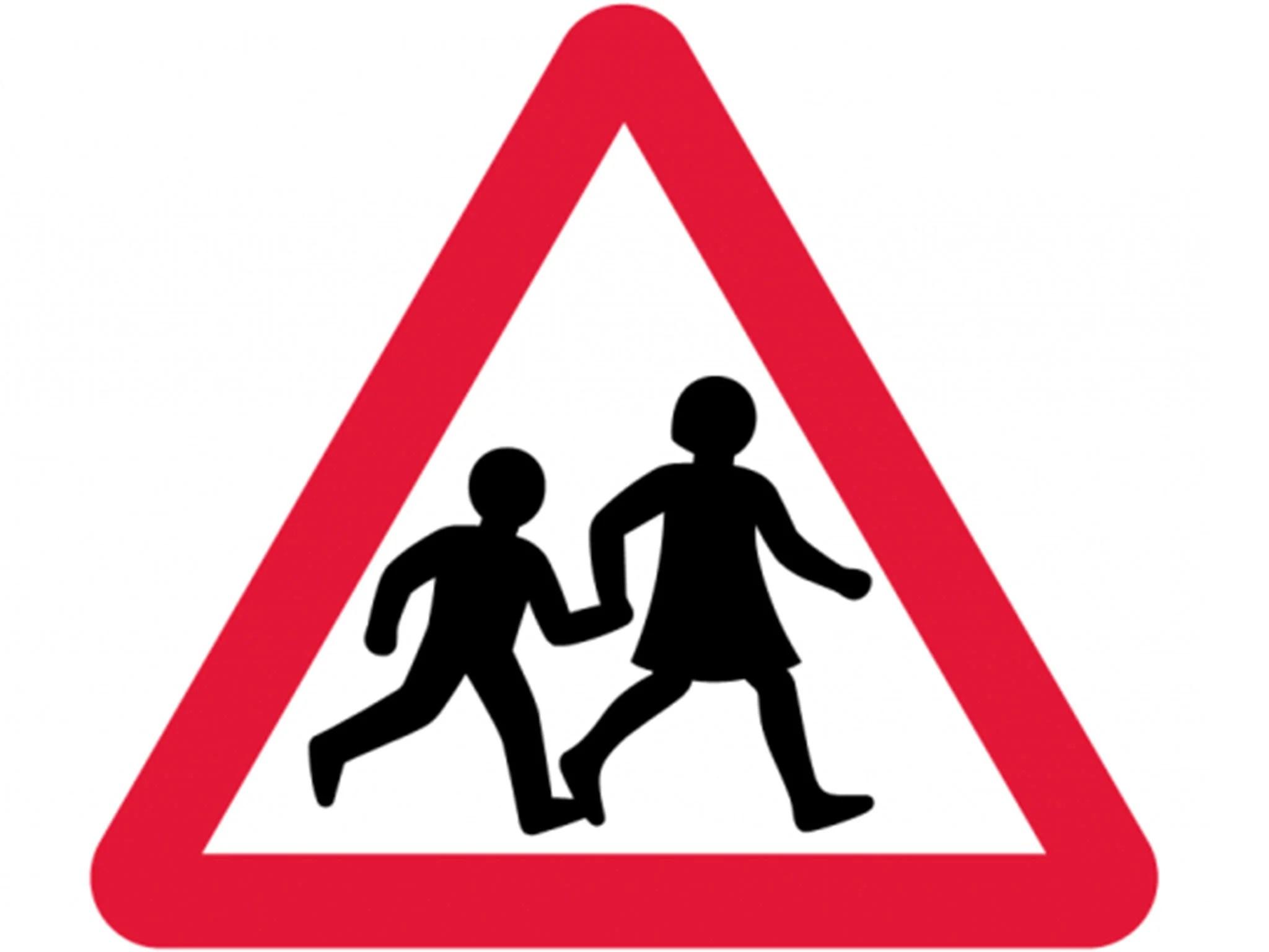 Iconic British Road Sign Of Two Schoolchildren Crossing