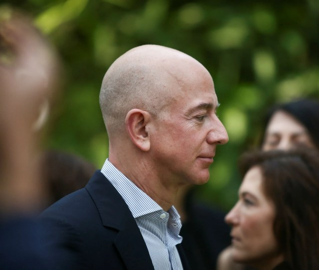 Amazon Founder And Ceo Jeff Bezos Looks Over A Balcony During An Opening Ceremony Event At