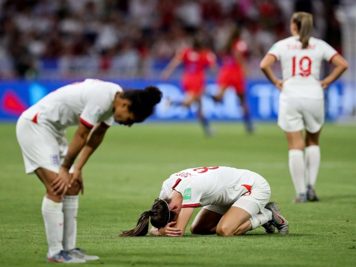 Image of england players after loss