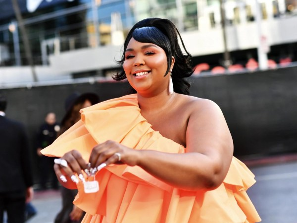 Lizzo wore a thong outfit to a basketball game and sparked a debate about bodyshaming