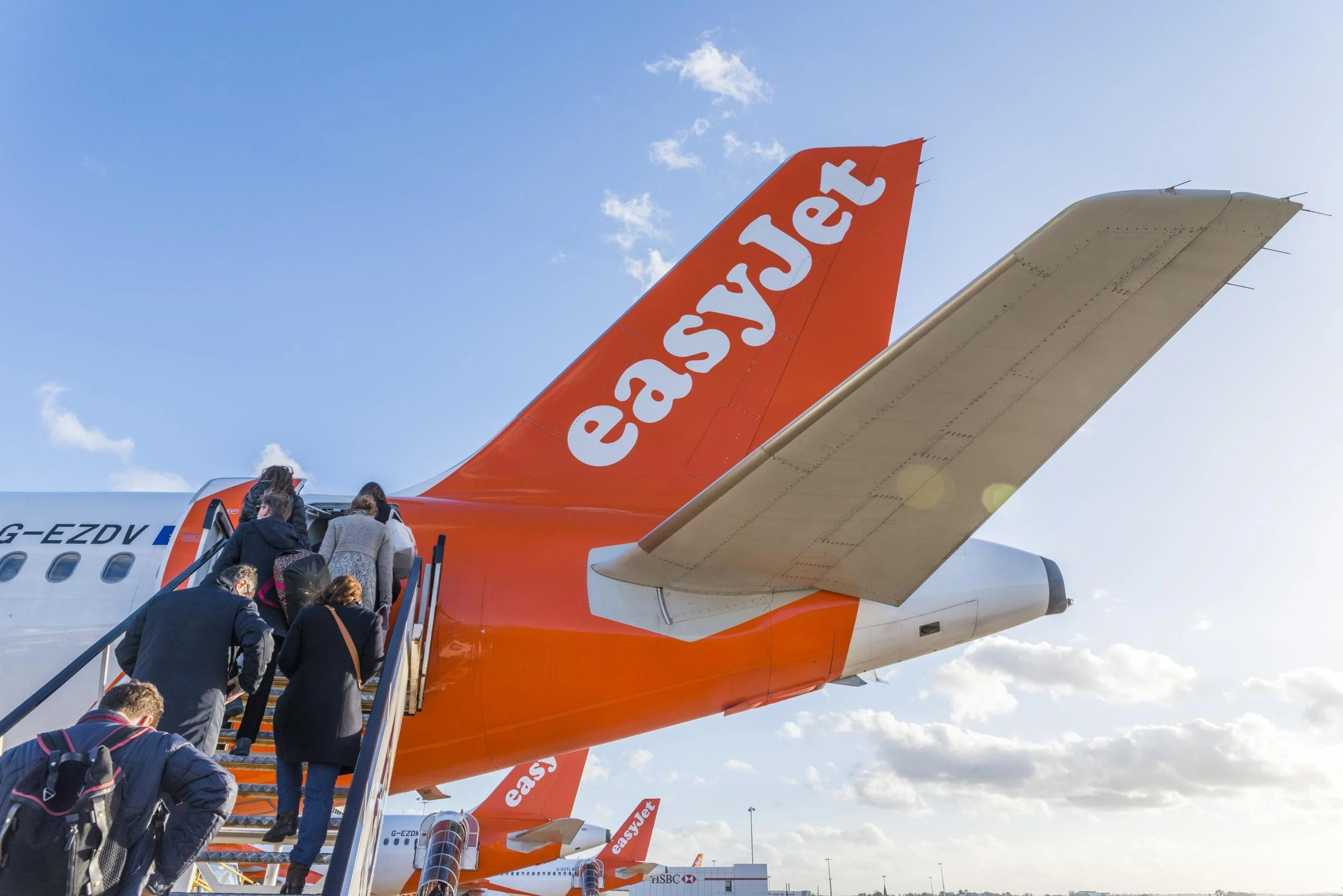The woman embarks on the easyJet flight using the child's passport