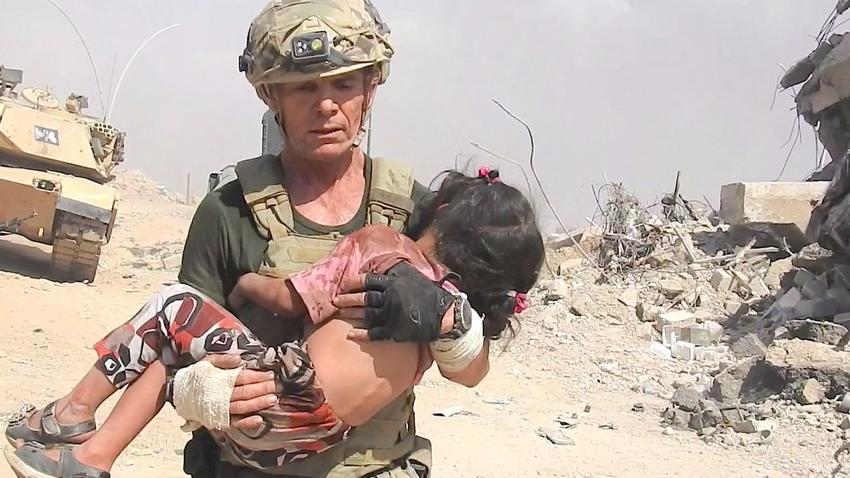 Image result for men dedicate their lives to rescuing kids on the front lines against ISIS.