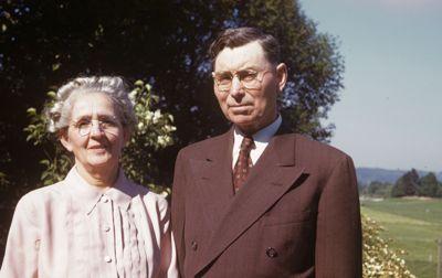 Older couple in Sunday attire outdoor portrait
