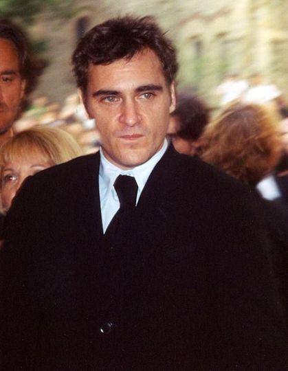 Dark haired man in black suit