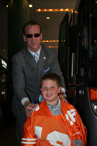 QB Manning  in business suit with fan in 2006