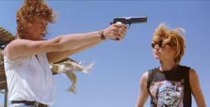 Med shot of Thelma & Louise shooting guns.