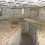Slave chambers for men with chains in floor.