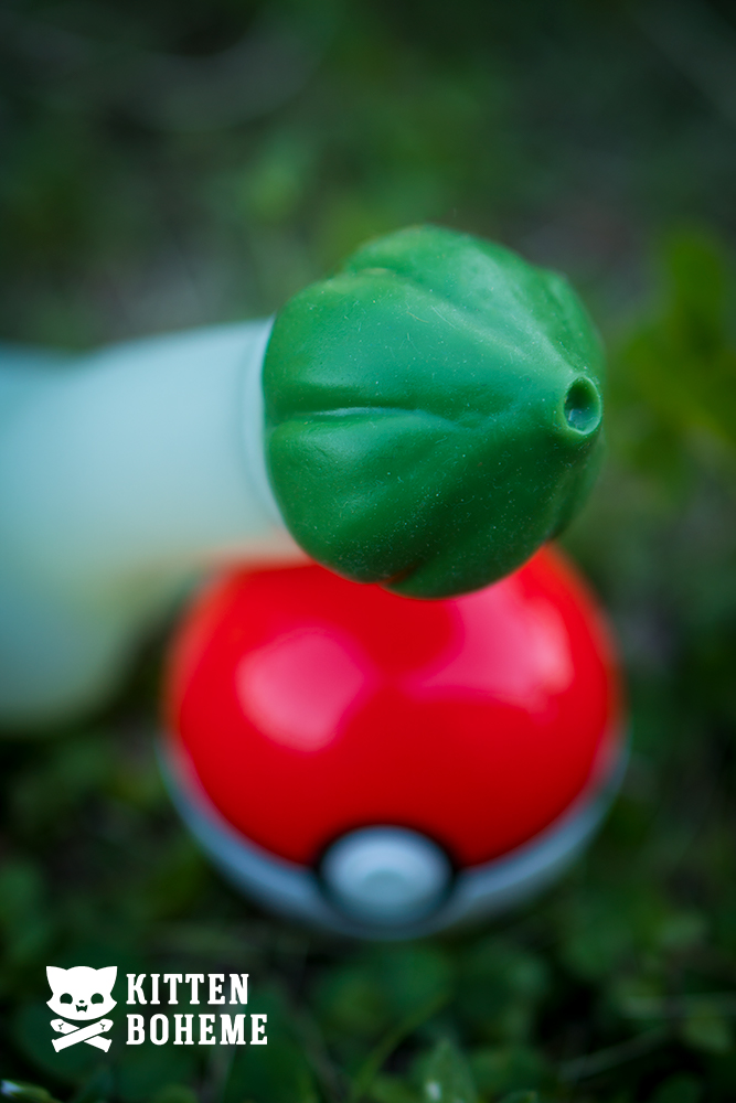 Geeky Sex Toys Pokemoan Bulby Silicone Dildo Seed Pod Head Resting on a Pokeball