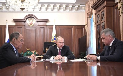 With Foreign Minister Sergei Lavrov (left) andDefence Minister Sergei Shoigu.