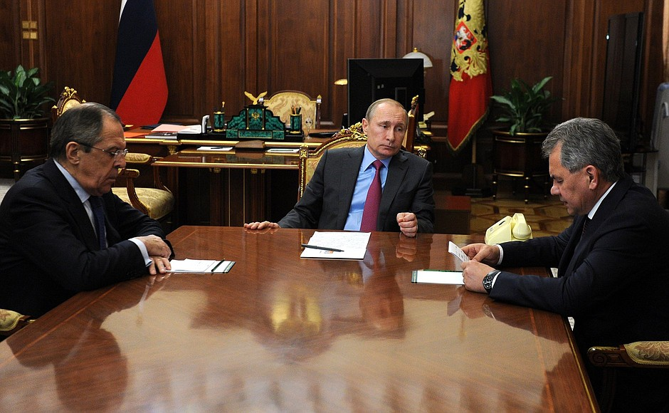 With Foreign Minister Sergei Lavrov and Defence Minister Sergei Shoigu.