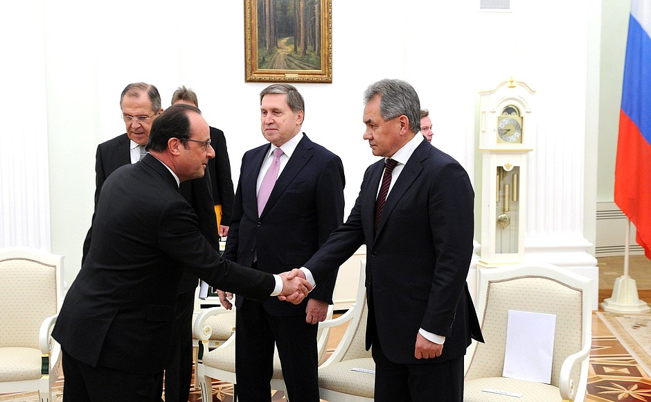 Before meeting with President of France Francois Hollande. With Foreign Minister Sergei Lavrov, Presidential Aide Yury Ushakov and Defence Minister Sergei Shoigu.