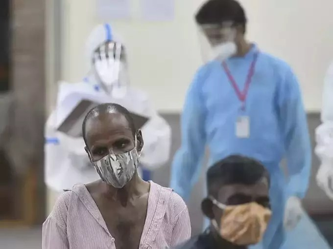 New Delhi_ Homeless COVID-19 patients receive treatment at an isolation ward fac ....