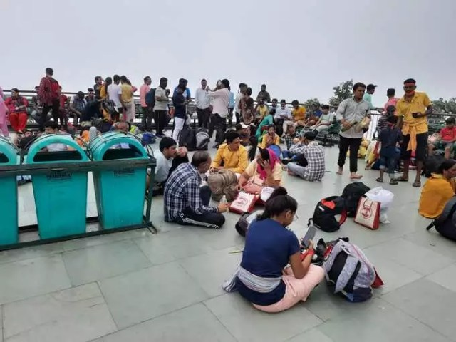 People sitting outside Bhaironghati temple