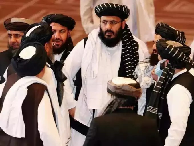 FILE PHOTO_ Taliban delegates speak during talks between the Afghan government and Taliban insurgents in Doha, Qatar.