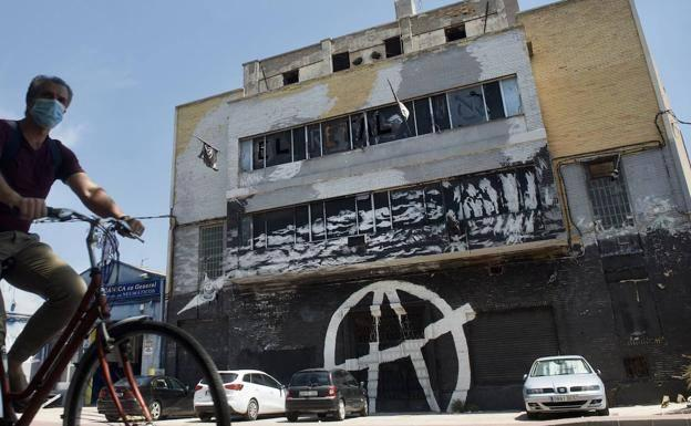Occupied ship with Okupa movement graffiti on the façade, in Murcia, in a file image.