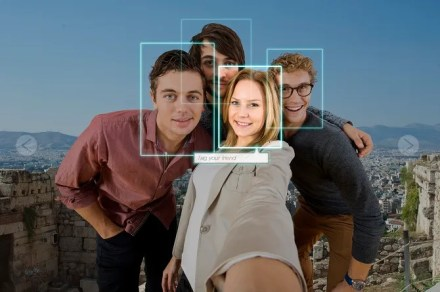 Photo of four people with facial recognition tagging