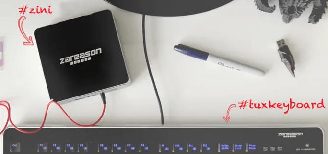 ZaReason Zini PC next to a keyboard