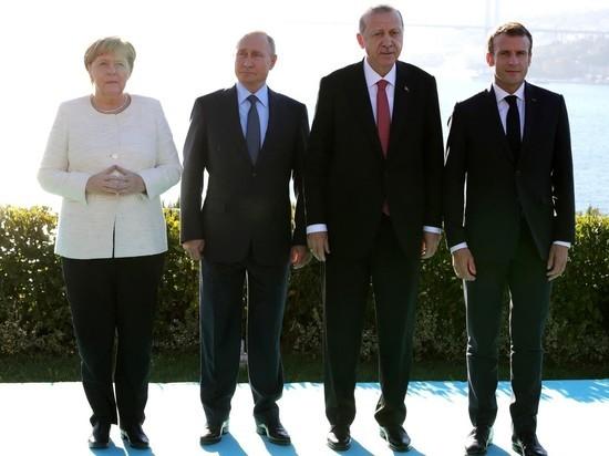 Меркель заговорила по-русски, увидев Путина в пальто