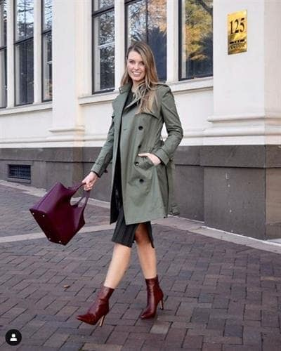 Aussie fashion influencer Bri Jones in a khaki jacket styled with cognac boots and matching handbag