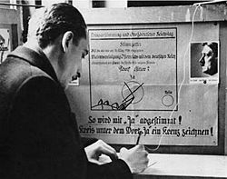 https://i2.wp.com/static.newworldencyclopedia.org/thumb/3/37/Voting-booth-Anschluss-10-April-1938.jpg/250px-Voting-booth-Anschluss-10-April-1938.jpg