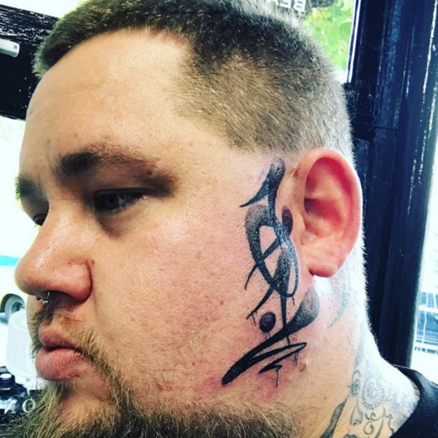 Rag'N'Bone Man made the bold decision to have a tattoo on his face