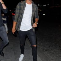 Love Island star 'Muggy' Mike Thalassitis parties the night away with 16-year-old girl in hotel room following wild night out after club appearance