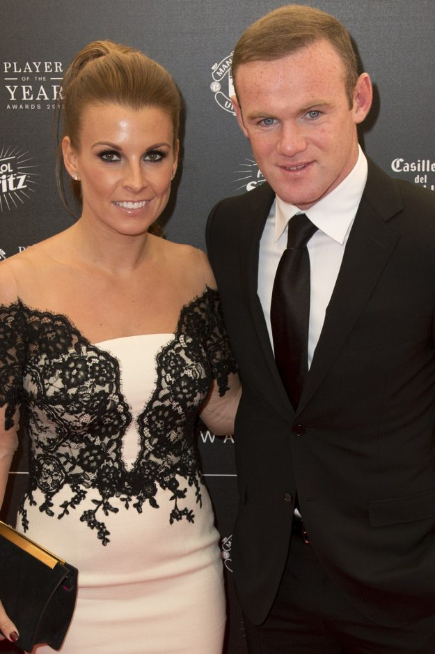 Manchester United's English striker Wayne Rooney and his wife Coleen pose for pictures on the red carpet as they arrive to attend the 'Manchester United Player of the Year Awards' at Old Trafford stadium in Manchester, northern England, on May 19, 2015. AFP PHOTO / OLI SCARFF (Photo credit should read OLI SCARFF/AFP/Getty Images)