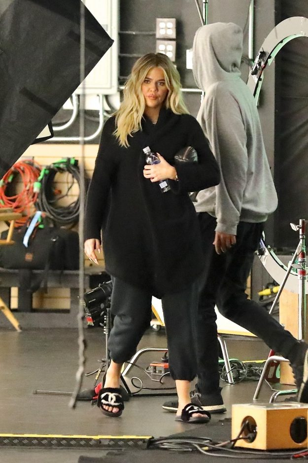 'Pregnant' and glowing Khloe Kardashian spends all day at the studio filming