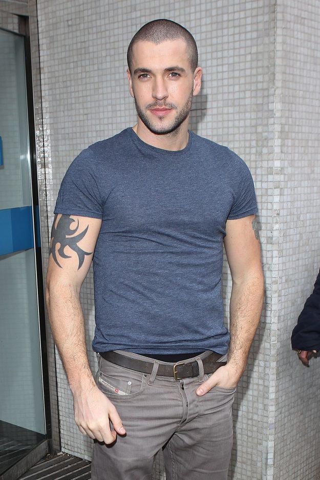 Shayne Ward has tribal tattoos on his am