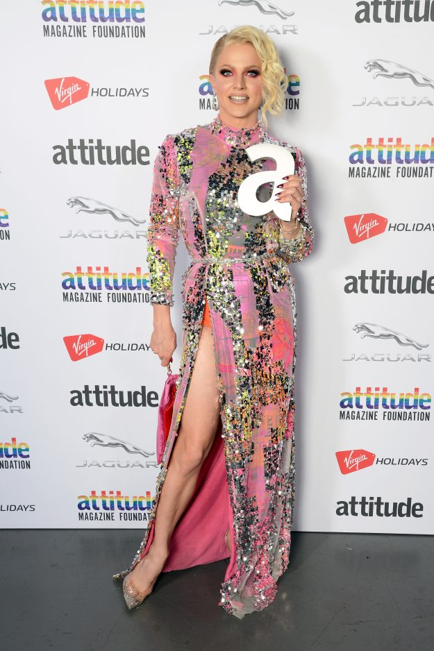 LONDON, ENGLAND - OCTOBER 11:  Winner of the 'Hero' award, Courtney Act, poses in the winner's room at The Virgin Holidays Attitude Awards at The Roundhouse on October 11, 2018 in London, England.  (Photo by Dave J Hogan/Dave J Hogan/Getty Images)