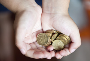 Child holding money out in hands