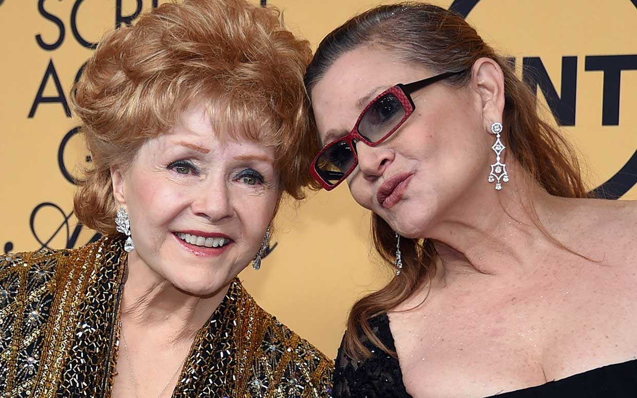 Debbie Reynolds (left), recipient of the Screen Actors Guild Life Achievement Award, and her daughter, actress Carrie Fisher, pose in the press room during the 21st Annual Screen Actors Guild Awards on January 25, 2015.