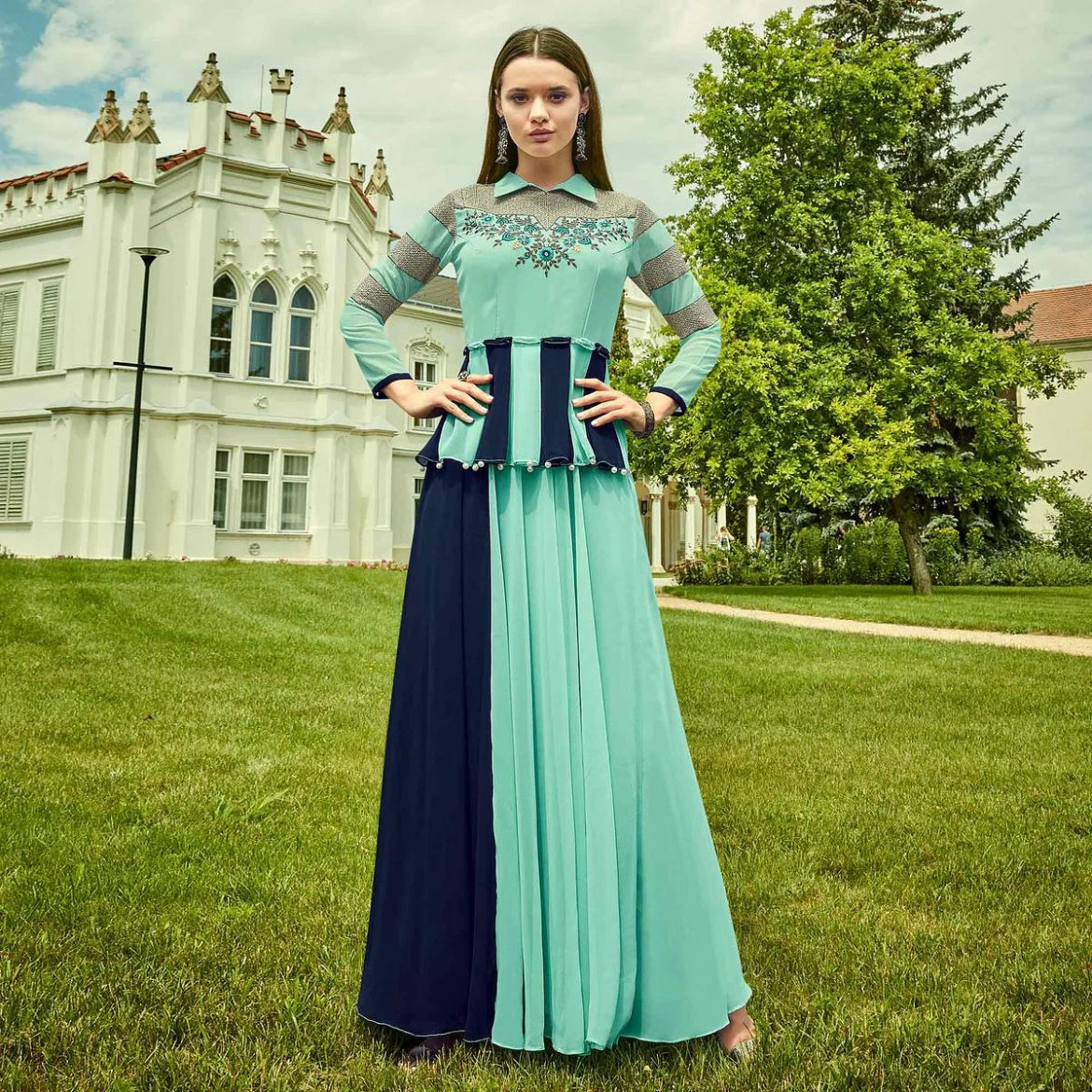 Adorable Aqua Blue Colored Party Wear Floral Embroidered Georgette Gown