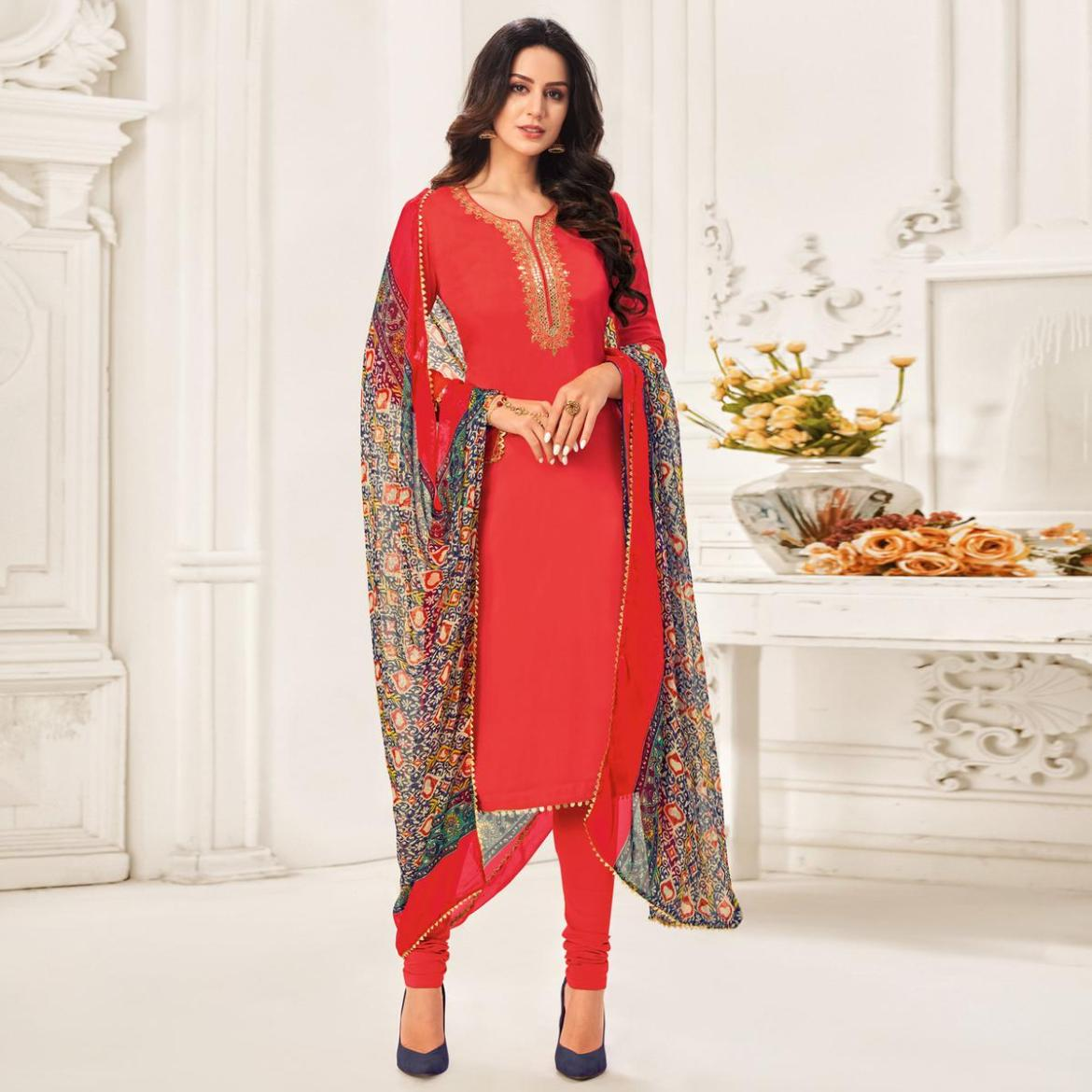 Intricate Coral Red Colored Partywear Embroidered Chanderi Dress Material