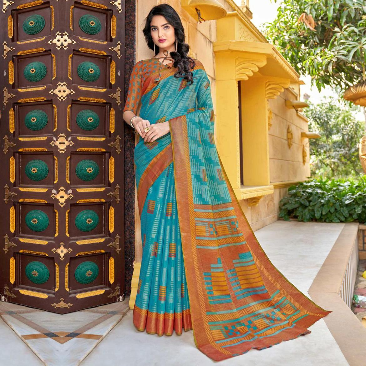 Excellent Sky Blue Colored Partywear Printed Brasso Saree