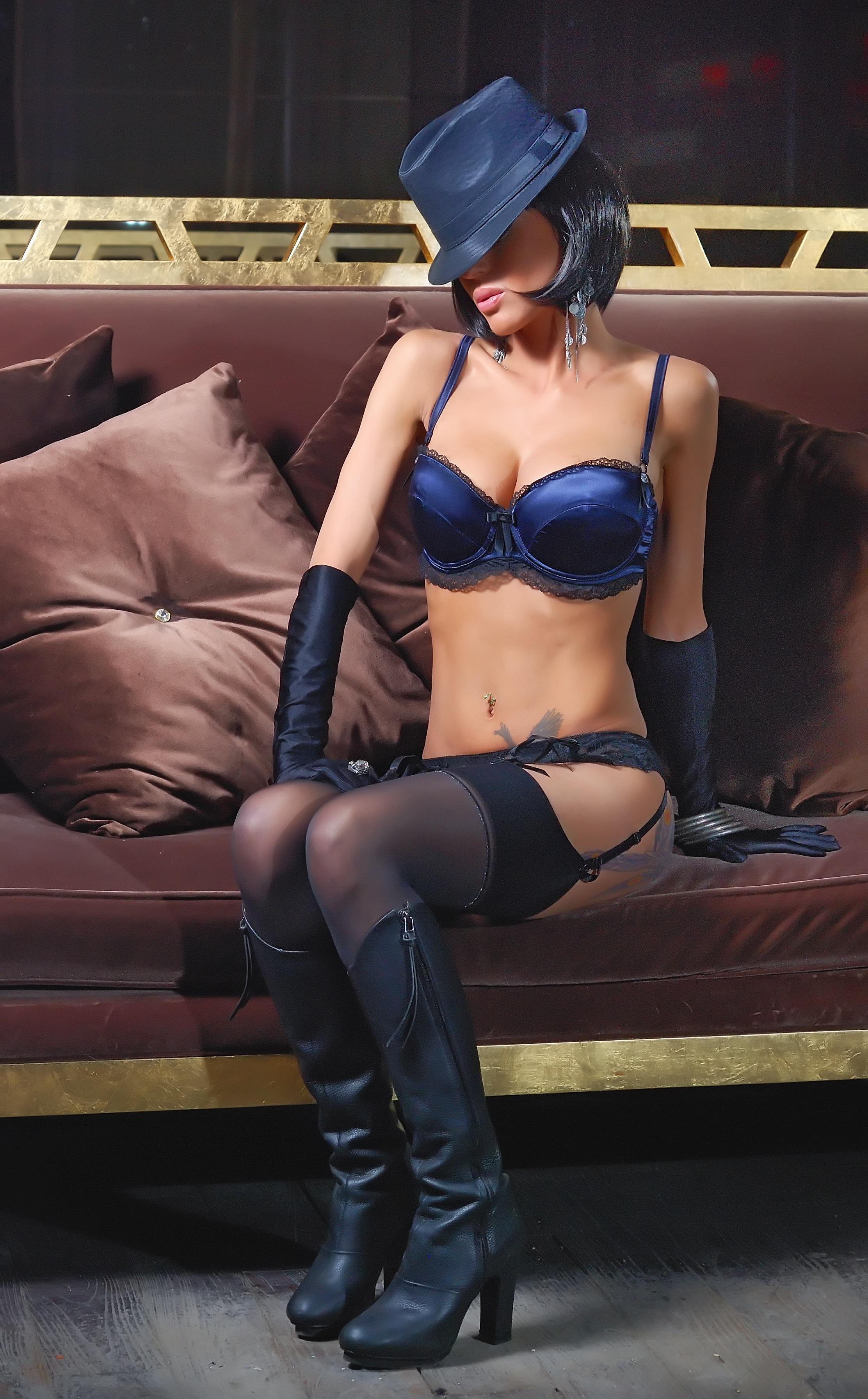Woman In Blue Bikini Sitting Brown Sofa Free Stock Photo