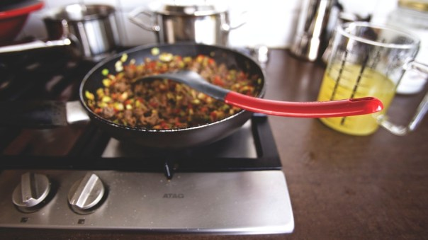 Dish Cooking on Black Non Stick Pan on a Burner