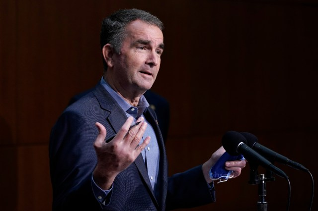 Virginia Gov. Ralph Northam gestures during a briefing at the Capitol in Richmond, Va.