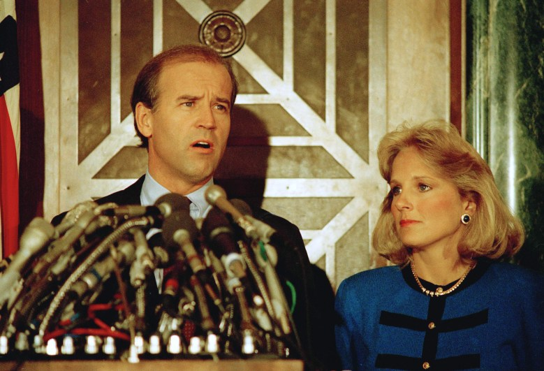 Sen. Joe Biden, pictured with his wife Jill, holds a news conference in Washington on Sept. 23, 1987, to announce he is withdrawing from the Democratic race for the presidential nomination.