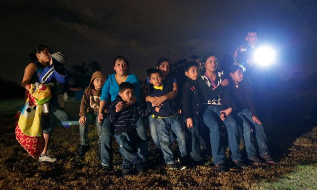 FILE - This June 25, 2014 file photo shows a group of young migrants from Honduras and El Salvador who crossed the U.S.-Mexico border illegally as they are stopped in Granjeno, Texas. The presidents of Guatemala, Honduras and El Salvador will present the United States with a proposed plan to stem child migration from their countries. The three Central American leaders are scheduled to meet with Vice President Joe Biden in Washington on Friday, Nov. 14, 2014.