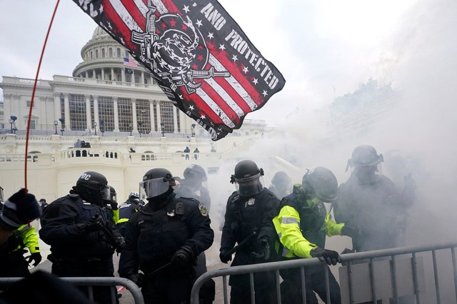 Police hold off supporters of Donald Trump who tried to break through a police barrier at the Capitol in Washington, D.C., on Jan. 6, 2021.