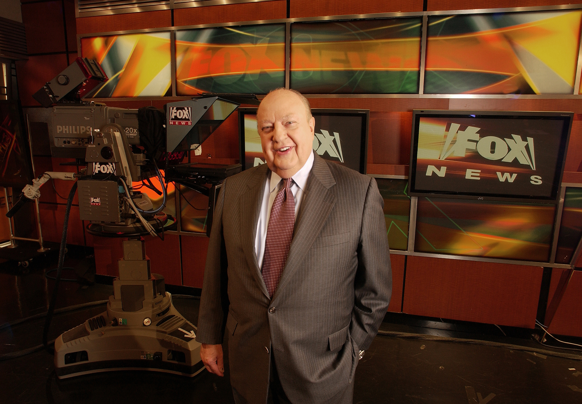 Former Fox New CEO Roger Ailes in front of a TV camera in the Fox News studio