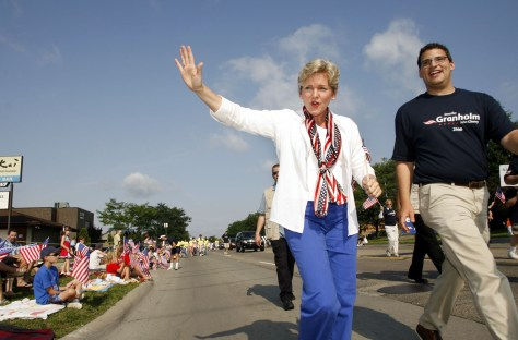 At a 2006 Fourth of July parade in Clawson, Mich., then-Gov. Jennifer Granholm marches with County Commissioner Dave Woodward.