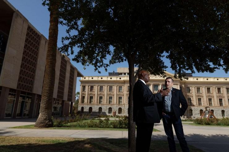 Arizona Rep. Walt Blackman - the first black Republican elected to the state legislature - greets Republican Rep. T.J. Shope - Speaker Pro Tempore of the Arizona House of Representatives - photographed Sept. 16, 2020 at the Arizona Capitol in Phoenix, Ariz.
