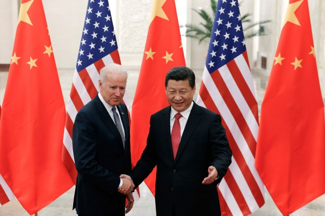 Chinese President Xi Jinping shakes hands with then-U.S. Vice President Joe Biden at the Great Hall of the People in Beijing in 2013.