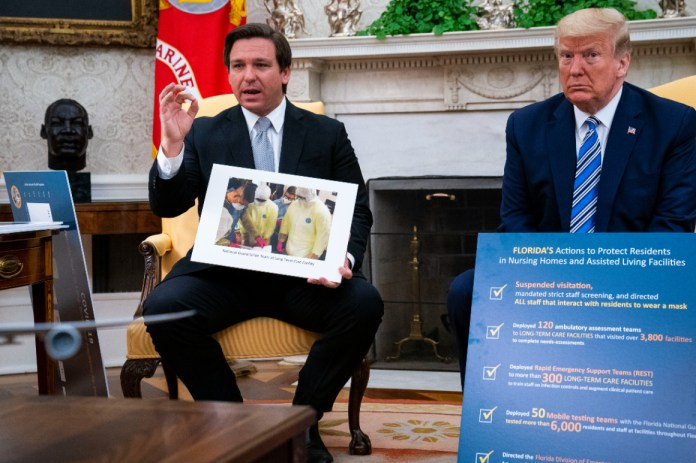 WASHINGTON, DC - APRIL 28: Florida Gov. Ron DeSantis (L) speaks while meeting with U.S. President Donald Trump in the Oval Office of the White House on April 28, 2020 in Washington, DC. Trump met with DeSantis to discuss ways that Florida is planning to gradually re-open the state in the wake of the COVID-19 pandemic.