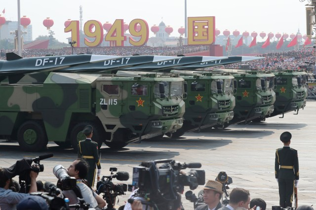 Military vehicles roll down a Beijing street during a Chinese military parade in October 2019.